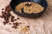 Cedar pine nuts on pan, on wooden table