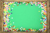 Photoframe with confetti on green background