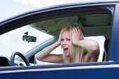 Frustrated Woman Screaming Sitting In Car
