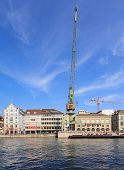 Zurich Cityscape With A Dockside Crane