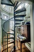 spiral staircase in home with lots of windows