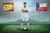 Soccer player stay at field. Game between Chili and Spain national teams.