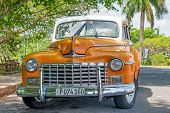 HAVANA,CUBA - APRIL 15, 2014: Beautifully restored old classic Dodge car in Havana. These antique ca