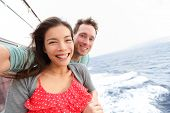 Cruise ship couple taking selfie self portrait photo romantic. Happy lovers, woman and man traveling