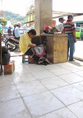 Street shoe repair shop in Bajawa Flores Indonesia