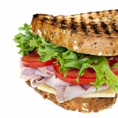 Ham sandwich with cheese, lettuce and tomato.  Grilled multigrain bread.