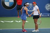 KUALA LUMPUR - APRIL 20, 2014: Zheng Saisai (blue) checks with partner Chan Yung-Jan (white) during