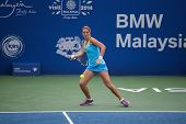 KUALA LUMPUR - APRIL 19, 2014:  Olga Savchuk returns in the semifinals of the BMW Malaysian Open in