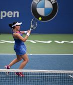 KUALA LUMPUR - APRIL 19, 2014: Zheng Saisai returns in the semifinals of the BMW Malaysian Open tenn