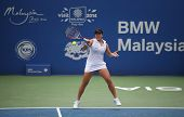 KUALA LUMPUR - APRIL 19, 2014: Chan YungJan returns in the semifinals of the BMW Malaysian Open tenn