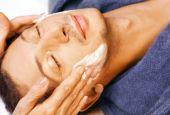 Man Gets Cream Massage On Face