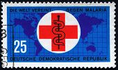 GERMANY,  CIRCA 1962: Postage stamp printed in GERMANY (DDR), showing International Red Cross and wo