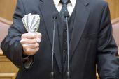Politician holding money