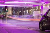 foto of underpass  - An underpass lit up by purple neon lights - JPG
