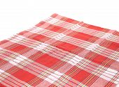 Red tablecloth pattern close up.