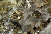 stock photo of pyrite  - extreme close up of gold crystal in nature for background - JPG
