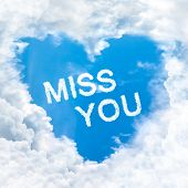 stock photo of miss you  - miss you word on blue sky inside heart cloud form - JPG