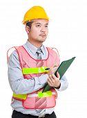 Asian engineer write on clipboard