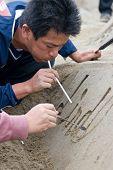 A sandsculpture artist at work