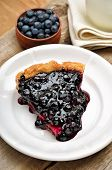 Piece Of Blueberry Pie On Wooden Table