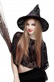 Girl in witch costume with a broom