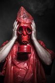 nuclear disaster, man with red mask and plastic suit