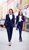 Beautiful Girls In Black Suits Walking The Street