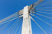Pillar Of Cable Bridge Against Blue Sky