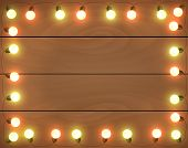 Christmas Lights On Wooden Background, Frame With Garlands