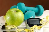 Healthy Apple And Sport With Brown Background