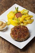 image of meatloaf  - bavarian meatloaf with potato salad on wood - JPG