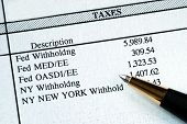 stock photo of payroll  - A list of withholding taxes from the pay stuff - JPG