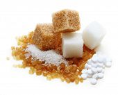 Brown, white cane sugar cubes and sugar substitute,sweetener on white background.