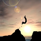 Concept or conceptual young man or businessman silhouette jump happy from cliff over water gap sunse