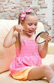 Little girl does makeup at light room