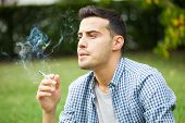 Man smoking a cigarette outdoor
