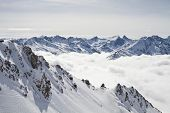 Snowy Mountain Peaks Above The Clouds