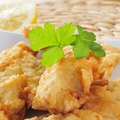 stock photo of hake  - closeup of a plate with battered and fried hake - JPG