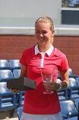 US Open 2014 girls junior champion Marie Bouzkova from Czech Republic during trophy presentation