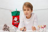 picture of letters to santa claus  - Boy writes a letter to Santa Claus - JPG
