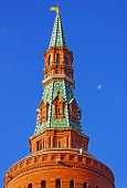 Top Of The Moscow Kremlin Tower With Blue Sky And Moon