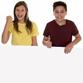 Smiling Children With An Empty Banner And Copyspace Showing Thumbs Up