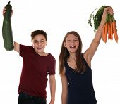 Healthy Eating Smiling Children With Carrots And Zucchini Vegetables