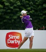 KUALA LUMPUR, MALAYSIA - OCTOBER 11, 2014: Karrie Webb of Australia tees off at the second hole of the KL Golf & Country Club during the 2014 Sime Darby LPGA Malaysia got tournament.