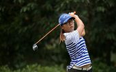KUALA LUMPUR, MALAYSIA - OCTOBER 11, 2014: Lydia Ko of New Zealand tees off at the fourth hole of the KL Golf & Country Club during the 2014 Sime Darby LPGA Malaysia golf tournament.