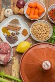 stock photo of tagine  - Ingredients for a Moroccan tagine dish with chick peas lamb carrots celery lemon onion cinnamon star anise - JPG