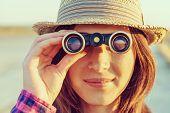 Tourist Looks Through Binoculars