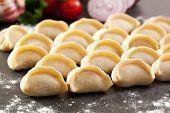 Raw Dumplings on Stone Tray