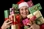 Delighted Old Lady Hugging A Dozen Wrapped Gifts.