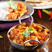 indian chicken vindaloo curry in balti dish close up